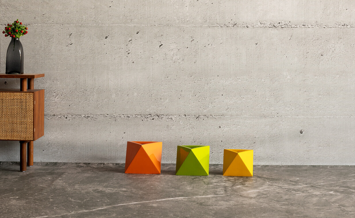 aria fiberglass planter in a triangular shape can be used as an indoor planter is manufactured by Bonasila planters